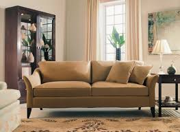 traditional family room furniture. cozy tufted beige sofa with grandinroad furniture and feizy rug for traditional family room design