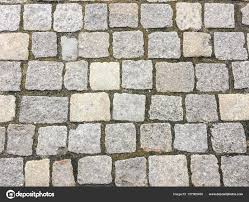 cobblestone floor texture. Stone Pavement Texture. Granite Cobblestoned Background. Abstract Background Of Old Cobblestone Close Floor Texture
