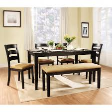 interior rectangle black wooden dining table with black wooden bench with cream fabric seat added