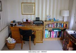 tidy office. a tidy pensioners office at home stock image