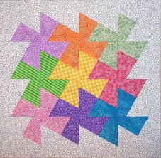 Lil' Twister quilt done in a cross pattern. Description from ... & Twister Quilt Block Tutorial - using Lil Twister Tool, a 9 patch of squares  bordered w/ strips. stitch it up & Twist away! Adamdwight.com
