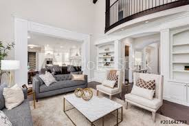 Beautiful living room interior with hardwood floors, view of kitchen ...
