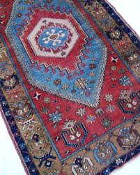 red and light blue vintage turkish traditional rug