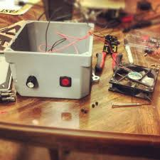 easy upgrade series building a diy stir plate for yeast starters 3 cut off the end of the power supply that would normally connect to your phone and strip the outer coating several inches down exposing two wires