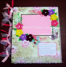 creative expressions baby girl scrapbook this cover page is my ultimate pride i love how it has turned out loads of roses from spellbinder s dies floral flourishes cherry lynn flourish man