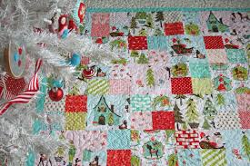 lovely little handmades: the patchwork christmas quilt~ all done!! & For the backing I used an aqua and white floral vintage sheet. I left the  white border and lace edging on the vintage sheet to give it a sweet little  touch. Adamdwight.com