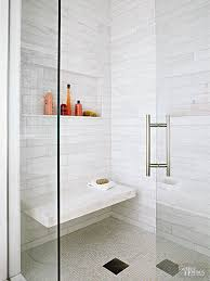 view in gallery convenient marble bench built into tiled shower wall