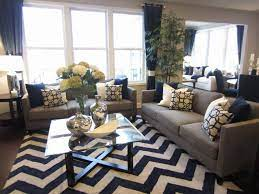 Silver and white accents keep the space light, and. Grey Is The New Black In This Pulte Design Trend Tip Color Continues To Be A Driving Force In S Navy Living Rooms Blue Living Room Living Room Design Modern