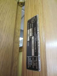 fire doors equipped with fire exit hardware will have a label stating this which indicates
