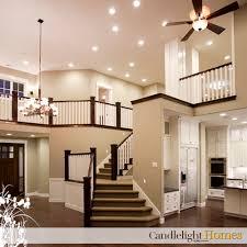 lighting in homes. CandlelightHomes.com, Utah, Homes, Homebuilder, Home, Staircase, Railing, Lighting, Interior Lights, Ceiling Fan, Chandelier, Wood Floor, Wooden Floors, Lighting In Homes H
