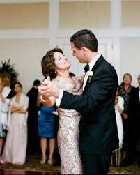 a really great wedding song for a mother and son to dance to, yet Wedding Dance You Raise Me Up sleeveless dress with a draped neckline suited every part of this pebble beach fête, including the mother son dance to josh groban's \u201cyou raise me up Josh Groban You Raise Me Up