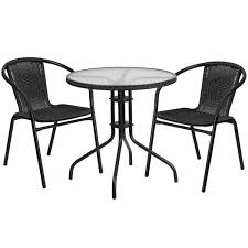 28 round glass metal table with black rattan edging and 2 black rattan stack