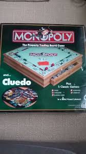 Wooden Games Compendium Monopoly deluxe set with wood cabinet and games compendium in 98