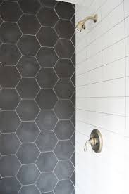 Like the charcoal tile as a shower accent, could tie into design of  upstairs bathroom