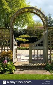 garden arch with gate wooden archway diverting feature gates leading into stone vision