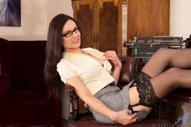 Ultra hot and naughty secretary strips down to her lingerie XXX.