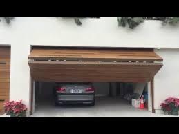 bi fold garage doorsEnzo 25 Upward Bifold Garage Door  YouTube