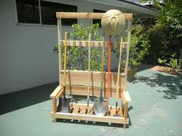 picture of garden tool rack with foldable bench