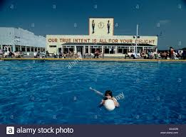 swimming pool beach ball background. Child In Swimming Pool With Beach Ball At Butlins Holiday Camp Moto Big On Reception Building Background