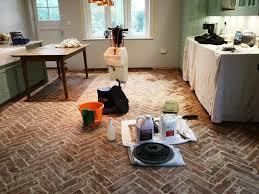 herringbone design terracotta floor during cogenhoe