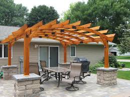 Exterior:Remarkable Curved Wooden Pergola Roof Design With Half Stone  Pillars Over Outdoor Dining Sets