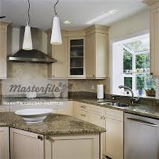 Work area lighting Home Office Granite Counters In Kitchen With Triangle Work Area Tile Back Splash With Pendant Lighting Window Greenhouse Stock Photo Food52 Granite Counters In Kitchen With Triangle Work Area Tile Back