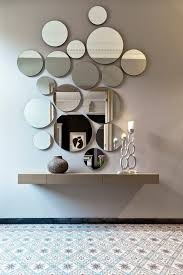 a circle wall mirror arrangement looks cool and modern such an unusual decor idea