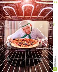 Fast Cooking Ovens Chef Cooking Pizza In The Oven Stock Photo Image 81405157