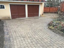 if you want to create an interesting patterned look for your driveway walkway or patio brick pavers could be a great choice of hardscaping material