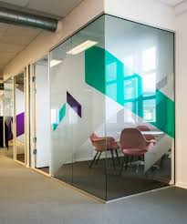 office glass walls. solid large shapes of colored glass office walls e