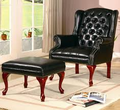 accent arm chair with ottoman. traditional black leather tufted button wingback accent chair with arm and ottoman on beige bordered