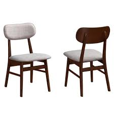 these retro style chairs showcases angeled out legs and curved backs in chestnut finished wood with off white cushioned seating and fits well within the