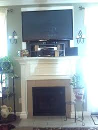 put cable box tv mounts over fireplace mounting tv over fireplace mantel
