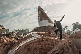 capturing the aftermath of s deadly earthquake msnbc a man stands on top of the broken dharahara tower in kathmandu 29