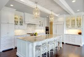 large crisp white kitchen with faux bamboo counter stools from ballard designs