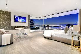 big master bedrooms couch bedroom fireplace: modern spacious master bedroom design with extensive city views floor to ceiling windows