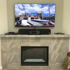 image of mounting tv above fireplace decor