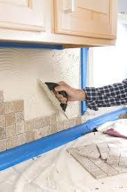 how to remove dried mortar from tile person putting grout on wall with trowel