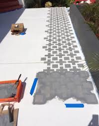 a diy stenciled patio using the square plus stencil