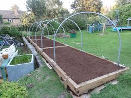 this follows on from my earlier one about raised bed construction i show the reader how i constructed a hoop tunnel for the raised beds