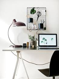 beautiful and modern home office with a vintage desk lamp a cactus and a black