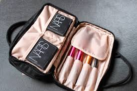 the other partment is specifically designed for make up brushes or a toothbrush and some more flat make up items as you can see it holds my nars blush