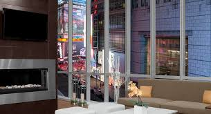 garden inn times square central a comfortable lounge with a beautiful view of times square below photo from hilton