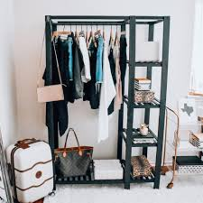 garment rack painted black wood hangers black white striped mini photo box with gold lid leopard storage box kendra scott travel jewelry case