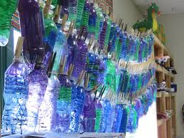 we painted cut splayed with a heat teacher use only and strung to create a chihuly inspired chandelier for our school lobby