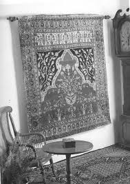 without damaging it how to hang a rug or textile
