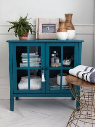 storage furniture for small spaces. with its small footprint this teal cabinet is great for storing extra handu2026 storage furniture spaces