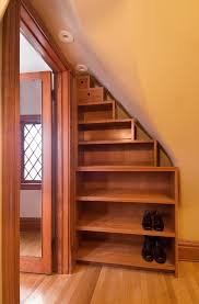 fabulous shoe rack design ideas come with wooden shoe rack under stair case wit 8 tier from small to large to black shoes and also wood closet door plus