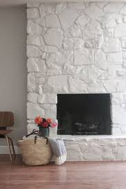 painted stone wallJust LOVE this painted rock stacked stone masonry fireplace