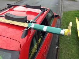 here are a few pictures of using my diy contraption to load the kayak onto my car this afternoon